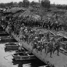 British troops crossing a pontoon bridge on the Western Front. - Otago Witness, 7.11.1917.