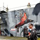 Artist Deow Owen, of Southland, after finishing his striking kaka mural on North Rd yesterday....