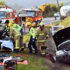 Emergency services tend to the driver of a four-wheel-drive, who was trapped in his vehicle after...