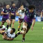 The Melbourne Storm's Felipe Kaufusi on the way to scoring against the Brisbane Broncos in the...