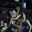 Temalisi Fakahokotau of New Zealand and Caitlin Bassett of Australia contest the ball during the...