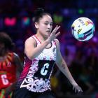 Whitney Souness, of New Zealand, gathers the ball during the Fast5 World Series Netball match...