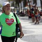 Ivonette Balthazar (67) walks near Copacabana beach in Rio de Janeiro. Photo: Reuters