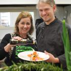 KiwiHarvest chief executive Deborah Manning puts the finishing touches to a meal prepared by...