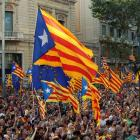 Marchers wave Catalonian nationalist flags as they demonstrate during Catalan National Day in...
