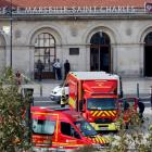 Emergency services vehicles are seen outside the Saint-Charles train station after French...