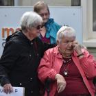 Margaret Matthews (76, left) comforts Nancye Coombes (88) at the  protest. Photos: Gregor Richardson