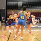 Epsom Girls' goal attack Bianca Nagaya (centre) is challenged by St Hilda's goal keep Mara...