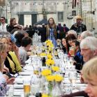 More than 70 people gather in Harbour St in April for the Forrester Laneway Long Lunch. Photo:...