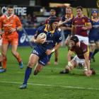 Otago's Tei Walden dashes for the line to score a try in the second half of their match against...
