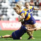 Bay of Plenty's Julia Buescher is tackled after making a run against the Otago Spirit at Forsyth...