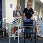 Dunedin artist Sheryl McCammon (left) and Resene staff member Kelly Hyslop. The three chairs...