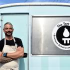 Matt Cross and Minty outside the Tart Tin bakery in St Kilda. PHOTOS: CRAIG BAXTER