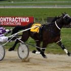 Titan Banner flies home to win the 80th running of the Hannon Memorial at Oamaru yesterday for...