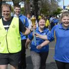 Senior Sergeant James Ure and Britney Kerr carry the Special Olympics Flame of Hope through...