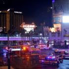 Las Vegas Metro Police and medical workers stage after a mass shooting at a music festival on the...