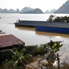 Submerged houses are seen at a flooded village after a heavy rainfall caused by a tropical...