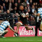 England's Nathan Hughes runs in to score their first try against Argentina. Photo Reuters
