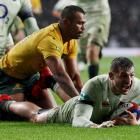 Jonny May crosses to score a try for England against Australia. Photo: Reuters