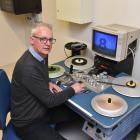 NHNZ technical and IT systems manager Wayne Poll plays with an old videotape machine at the...