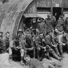 Members of the New Zealand Field Ambulance Squad await dinner near the front lines. — Otago...