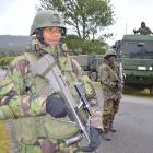 Soldiers patrol a checkpoint in Inverness St, Dunollie, outside O'Brien Park this morning as...