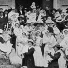 Mothers, nurses and babies on the steps of Burns Hall during Baby Week. - Otago Witness, 7.11.1917.