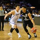 Tall Blacks guard Corey Webster dribbles past his Korean defender Junghyun Lee. Photo: Supplied