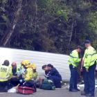 Passengers of a van that crashed on the West Coast, killing a passenger, are comforted at the...