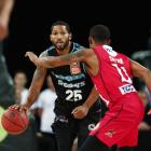 New Zealand Breakers guard DJ Newbill handles the ball while being guarded by Perth Wildcats...