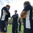 Joe Root, the England cricket captain talks with Jonny Bairstow and Bruce French at a training...