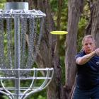 Leon Botha, of Christchurch, floats his disc towards a  target at Waiora Scout Camp yesterday....