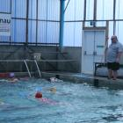 IMG: 7111 Graeme Laing with swimmers getting finer points on their training programme. Photo:...