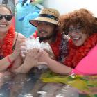 Jacqui Graham (left), Jefrey Lunas and Candice Makene visualise tropical islands as they spend...