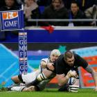Liam Squire scores for the All Blacks against the French Barbarians. Photo: Reuters