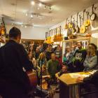 Nick Bollinger hosts a LitCrawl event in Alistair's Music, Cuba St, Wellington. Photo: Supplied