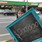 Caversham Four Square owner Sandra Shum is searching for a lucky customer yet to claim their $200...