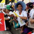 People gather outside the the residence of Cardinal Charles Maung Bo, Archbishop of Yangon, where...