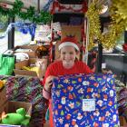 Wakari School pupil Isabelle Stanton brings a big gift on to the bus during a ''Stock the Bus''...