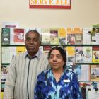 """Dr Rama T Ragupathy and his wife Villi in Dunedin yesterday underneath their motto: """"Love All..."""