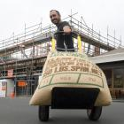 Allpress Dunedin head roaster Richard Page heads to the expanding business with a sack of coffee...