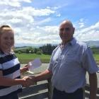 Briar Swanson is congratulated by South Canterbury North Otago Deer Farmers Trust member Keith...
