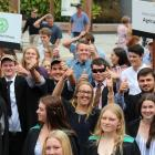 Telford students show their excitement marching down the main street of Balclutha yesterday as...