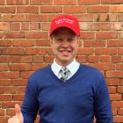 Great stuff ... Campbell and Sons managing director Clark Campbell models a cap promoting the...