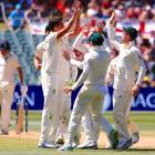 Australian players celebrate the dismissal of England's Craig Overton. Photo: Reuters