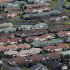A view of suburban housing south of Auckland.  Photo by The New Zealand Herald.