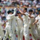 Josh Hazelwood celebrates a wicket with his team mates yesterday as Australia close in on another...