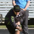 Jo Edwards delivers her bowl as Dale Rayner looks on during their women's pairs match at the...