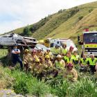 Senior Constable Craig Bennett (left), of Lawrence, and members of Fire and Emergency New Zealand...