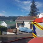 Fire and Emergency New Zealand attend a fire at a property in North Dunedin. Photo: Vaughan Elder